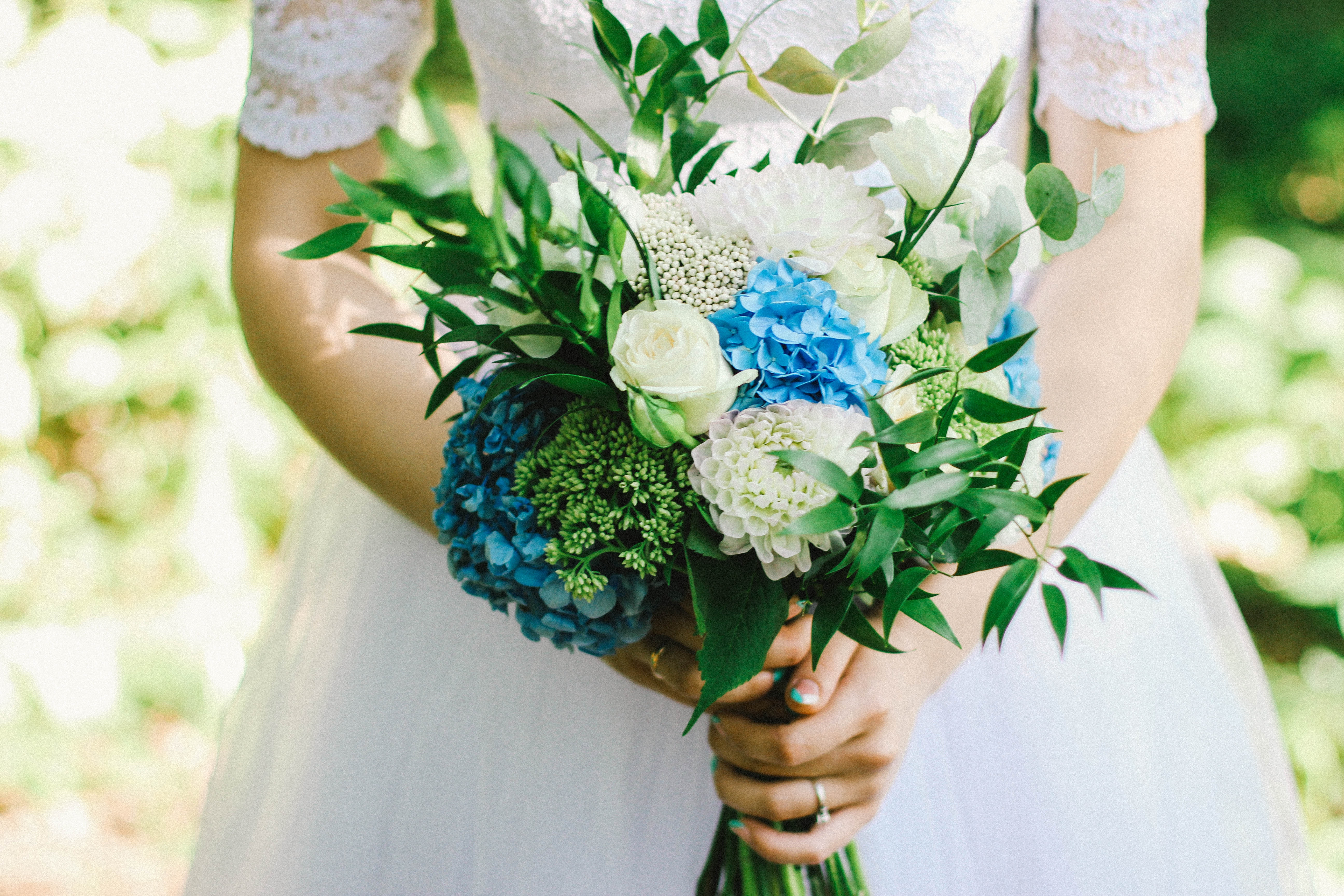 close up of bride holding her wedding flowers