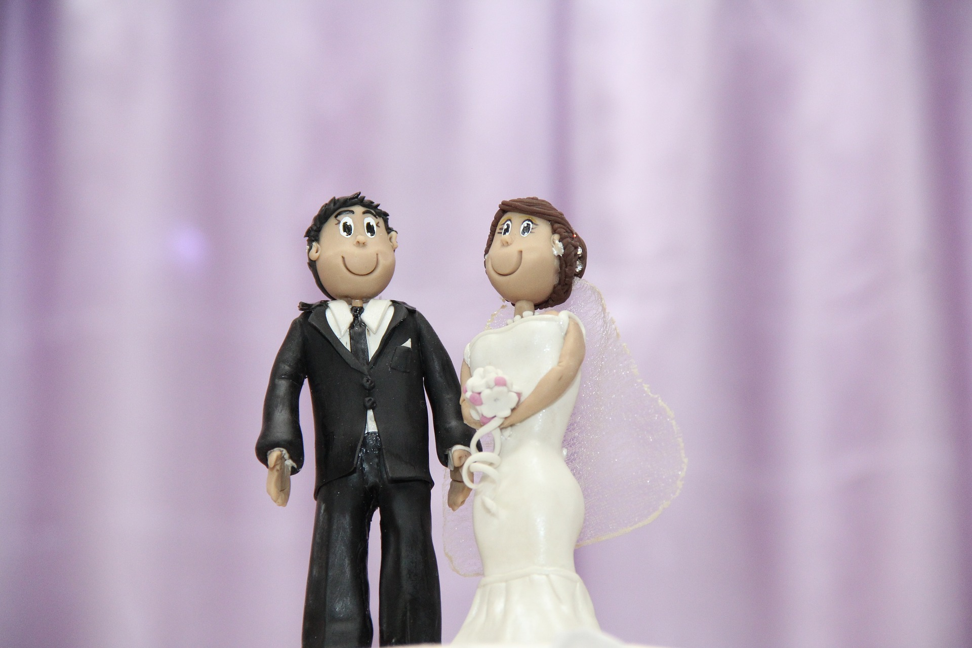 wedding cake topper with a bride and groom