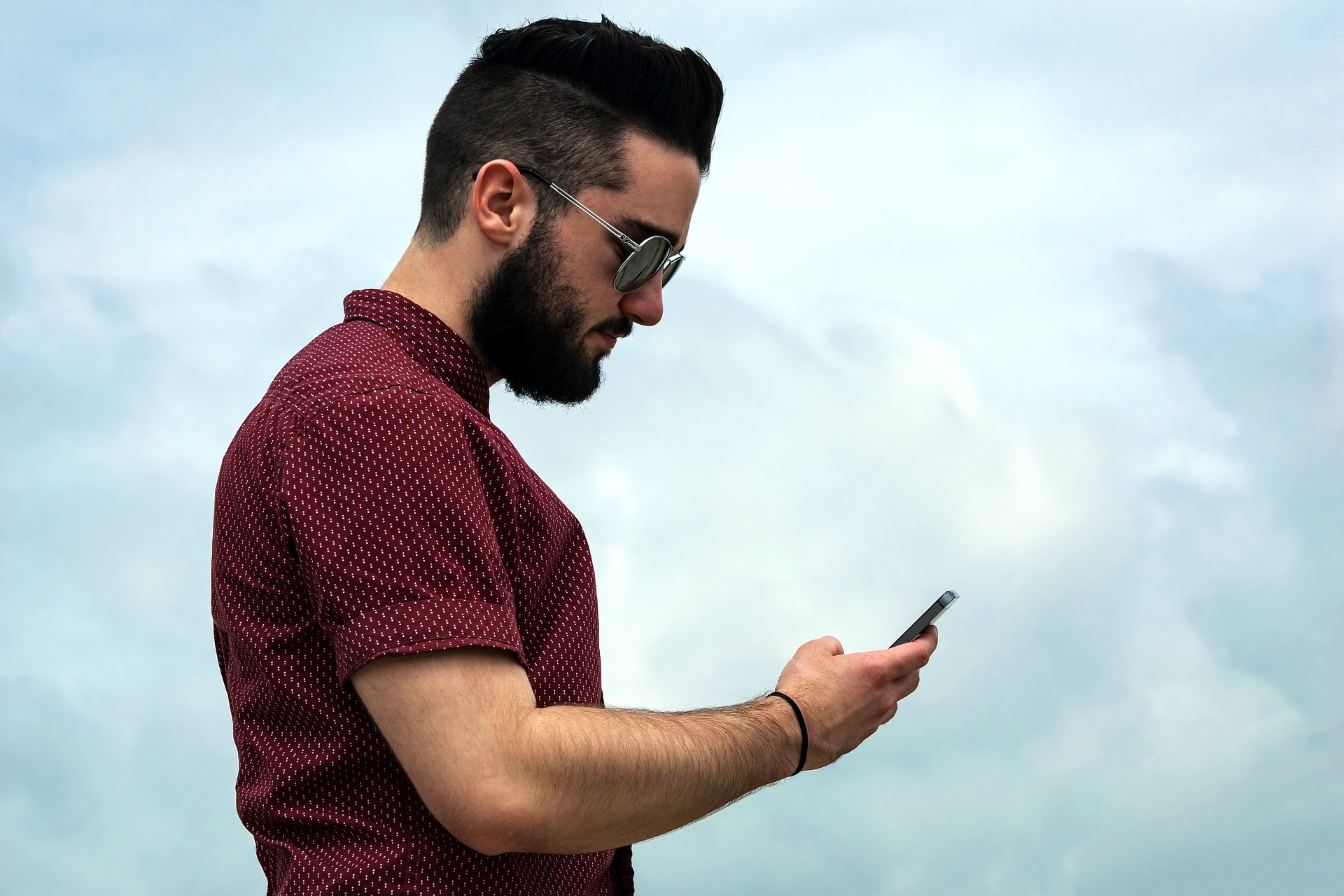 man texting on his phone