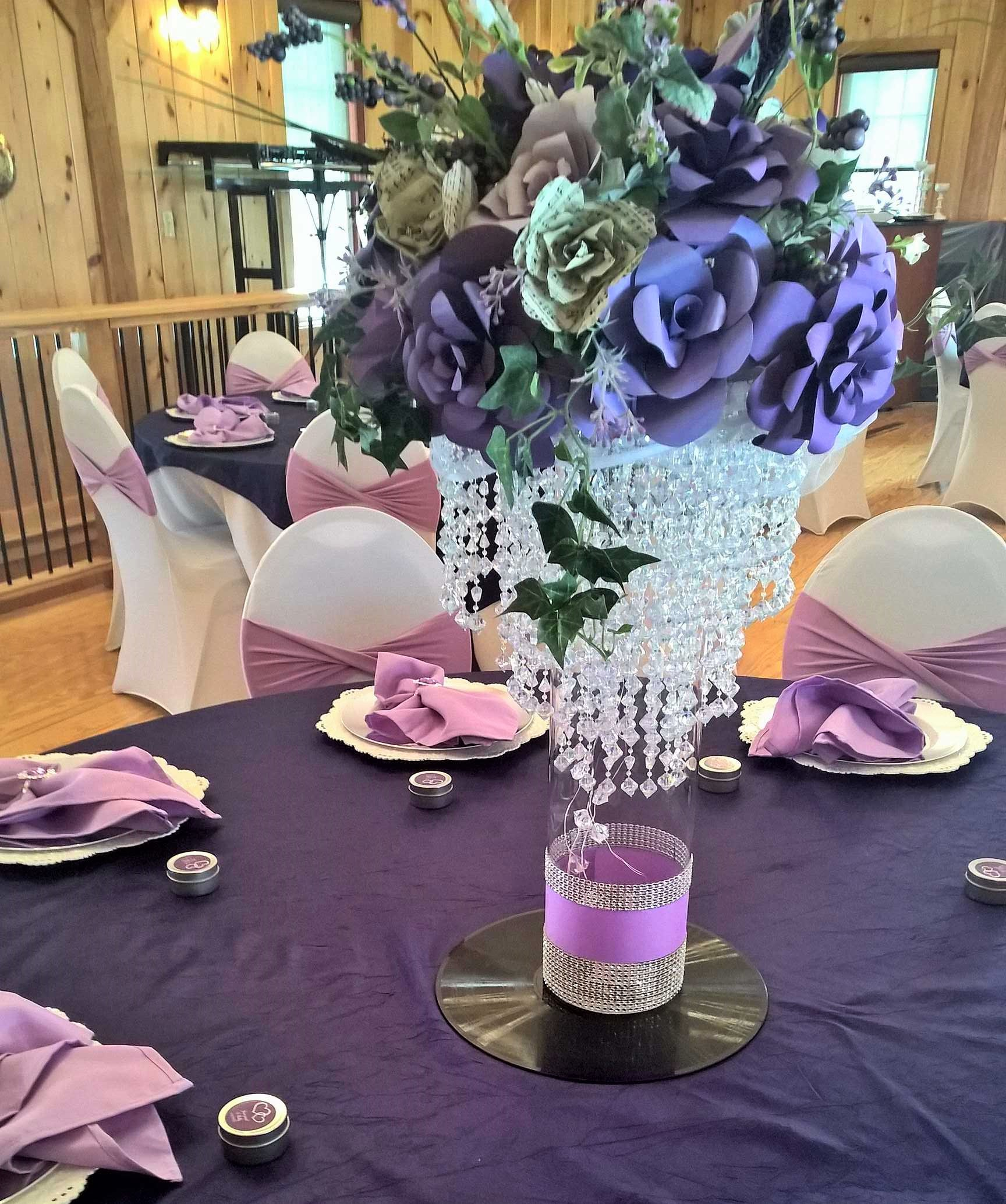 Purple and white table decorations as part of a wedding theme