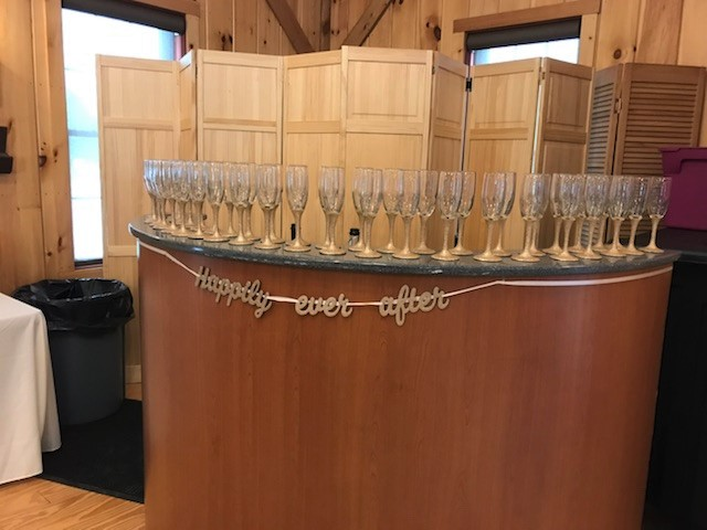 Bar lined with glasses of champagne