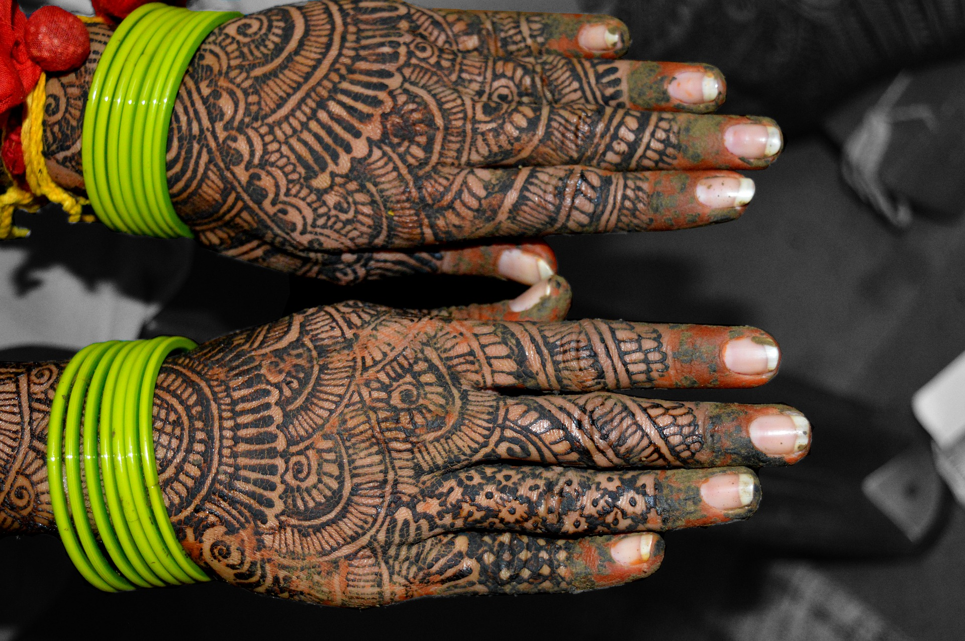 picture of hands with henna design, one of the wedding traditions from India